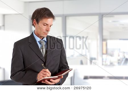 Mature man writing some notes