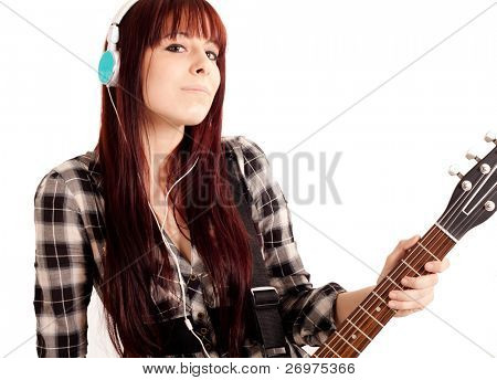 Pretty young female rocker girl with guitar