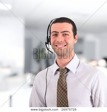 Handsome smiling young man wearing an headset