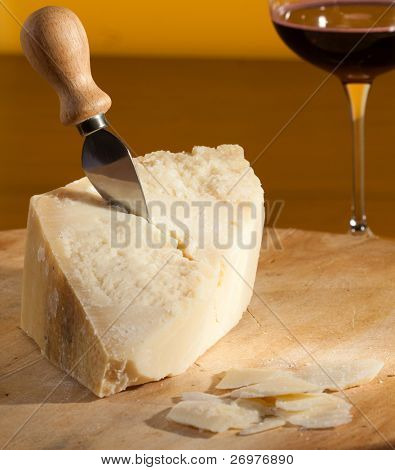 A typical italian cheese with knife.