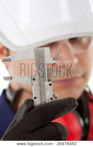 Engineer looking closely at a gauge