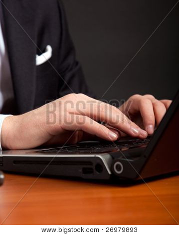 Businessman at work on his laptop