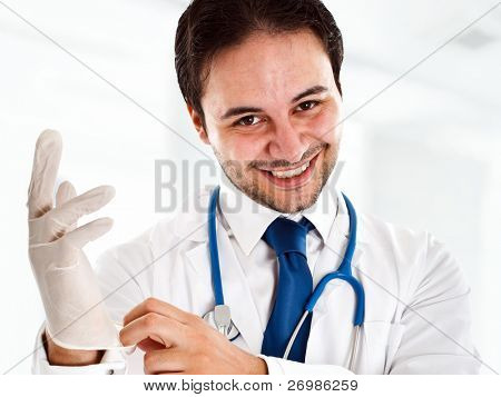 Portrait of a friendly doctor wearing a glove