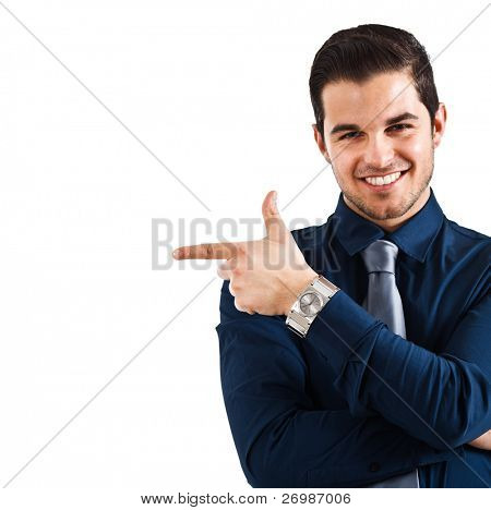 Portrait of a smiling man pointing his finger on the copyspace