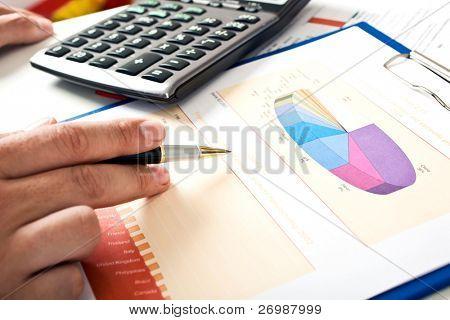 Closeup of businessman's hand doing paperwork