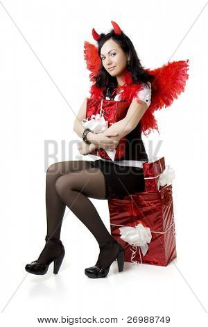 Picture of a girl in a devil costume with a gift