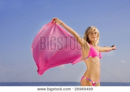 Picture of the girl in the pink bathing suit on the beach