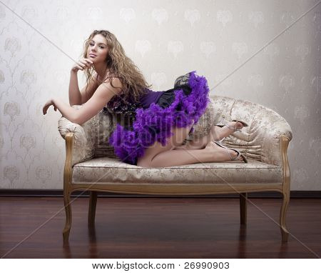 Image of a beautiful girl on a luxurious couch