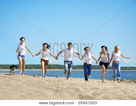 Image of a group of people relaxing on the beach