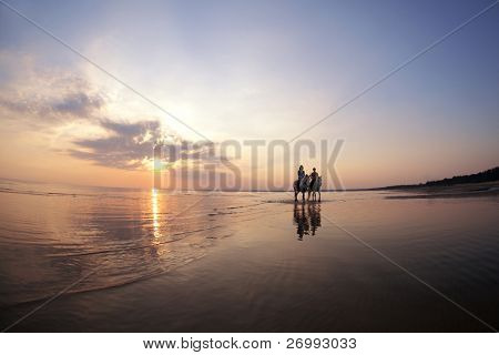 The image of a couple in love at sunset in the sea