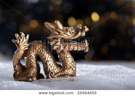 Dragon symbol of the year 2012 on a bright background