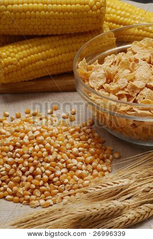 free ears of wheat,Corncob and cereal flakes in a small bowl