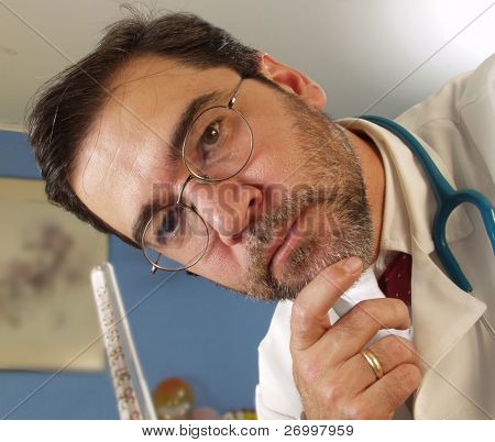 doctor measuring the temperature with a thermometer