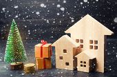 Wooden Houses And Christmas Tree. Christmas Sale Of Real Estate. New Year Discounts For Buying House poster