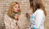 Tips How To Get Rid Of Cold. Woman Feels Badly Ill Sneezing. Girl In Scarf Hold Tissue While Doctor  poster