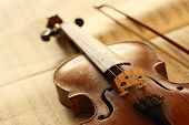 stock photo of mozart  - antique violin with fiddlestick - JPG