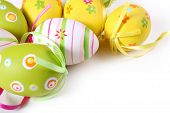 pic of easter-eggs  - Festive decorations eggs reads Happy Easter on white