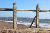 Wooden Groynes On Dawlish Warren Beach, Devon poster