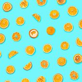Set Of Dried Slices And Half A Slice Of Orange And Lemon As Background, Isolated On Blue Background poster