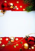 stock photo of christmas lights  - Design a Christmas greeting with a paper on a red background - JPG