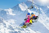 Family In Ski Lift In Mountains. Skiing With Kids poster