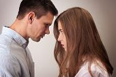 Profiles Of Distressed Couple Of Man And Woman Looking At Each Other Close Nearly Touching Forehead  poster