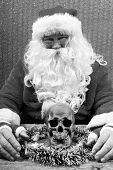 Santa Claus. Santa Crime Scene. Santa Claus holds a Human Skull for an unexpected Evil Santa Photo S poster