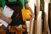 Handyman With Hands On Waist And Tool Belt With Construction Tools Against Wood Background. Diy Tool poster
