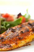 picture of plate fish food  - Whole seasoned fillet of white fish on mixed salad with tomatoes - JPG