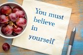 You must believe in yourself - handwriting on a napkin with grapes poster