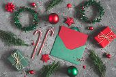 Christmas Composition. Gifts, Fir Tree Branches, Envelope, Card, Red Decorations On Black Background poster