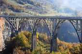 picture of yugoslavia  - Djurdjevica Tara Bridge is a concrete arch bridge over the Tara River in northern Montenegro - JPG