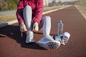 Young Fitness Woman Runner Athlete. Girl  Jogger Training And Doing Workout Outdoors In City. Female poster