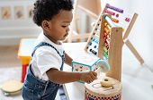 Young boy playing with educational toys poster