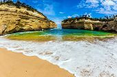 The Great Ocean Road of Australia. Magnificent little beach  in ocean fjord of Pacific ocean. The co poster