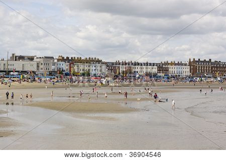 Holiday makers on Weymouth Beach
