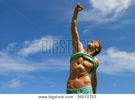 Happy Fit Man With His Arm Raised In Joy