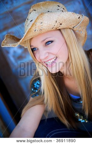 Attractive Blond Model Smiles While Wearing Cowboy Hat