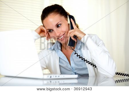 Smiling Female Conversing On Phone