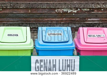 Collection of large colorful trash cans (garbage bins)