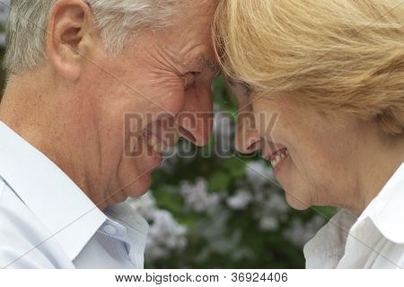 Old couple enjoy union with nature