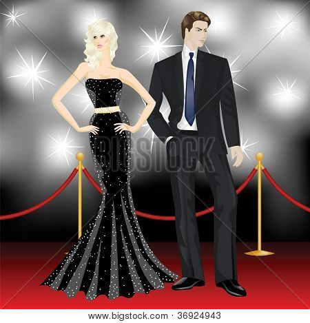 Fashion Woman And Elegant Man In Front Of The Paparazzi On The Red Carpet
