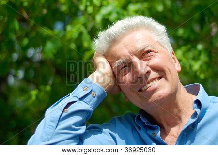 Nice old man is enjoying the air
