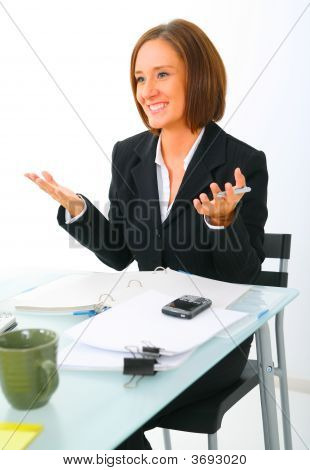 Businesswoman Making Hand Gesture While Talking