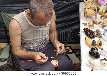 Sorochinskaya Fair.  Man Decorates Crafts.