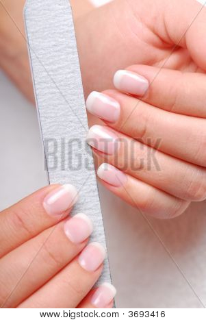 Polishing Of Nails By Emery Board