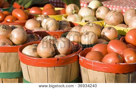 Baskets of onions and tomatoes