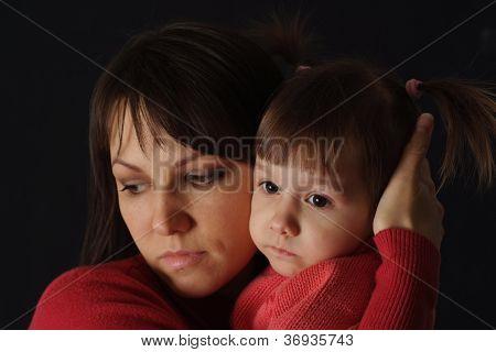 Pretty sad Caucasian mama with a daughter