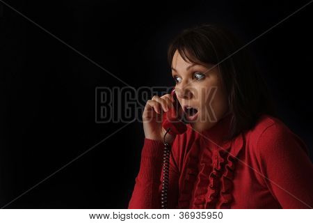Good sad Caucasian woman talking on the phone