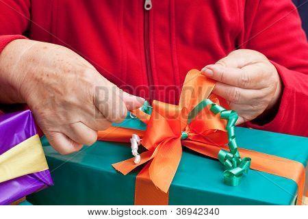 Senior Citizen Wrap Or Unpack Gifts